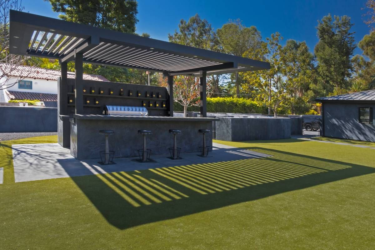 pergola installed for outdoor kitchen