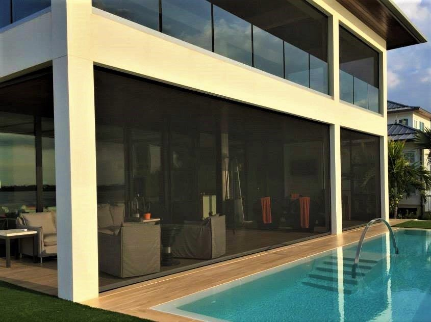 retractable screens installed next to a pool